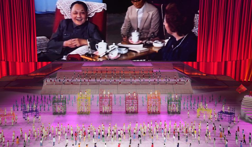 In this file photo, late Chinese leader Deng Xiaoping is displayed on screen during a gala show ahead of the 100th anniversary of the founding of the Chinese Communist Party in Beijing on Monday, June 28, 2021. The communists have ruled China single-handedly for more than 70 years since Mao Zedong led them to power in 1949. After his death in 1976, they started a sharp turn under then-leader Deng, embracing a market economy that has transformed what was a poor country into an economic power. (AP Photo/Ng Han Guan)  **FILE**