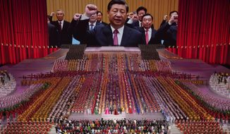 Chinese President Xi Jinping is seen leading other top officials pledging their vows to the party on screen during a gala show ahead of the 100th anniversary of the founding of the Chinese Communist Party in Beijing on Monday, June 28, 2021. For China's Communist Party, celebrating its 100th birthday on Thursday, July 1 is not just about glorifying its past. It's also about cementing its future and that of its leader, Chinese President Xi Jinping. (AP Photo/Ng Han Guan)