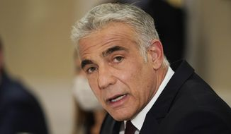 In this June 27, 2021, file photo, Israeli Foreign Minister Yair Lapid meets with Secretary of State Antony Blinken in Rome. Israel's new foreign minister is heading to the United Arab Emirates for a state visit, the first high-level delegation by an Israeli official since the two countries signed an agreement to normalize relations last year. Lapid took off on Tuesday, June 29, for Abu Dhabi, where he will inaugurate the new Israeli Embassy and meet Emirati ministers. (AP Photo/Andrew Harnik, File)