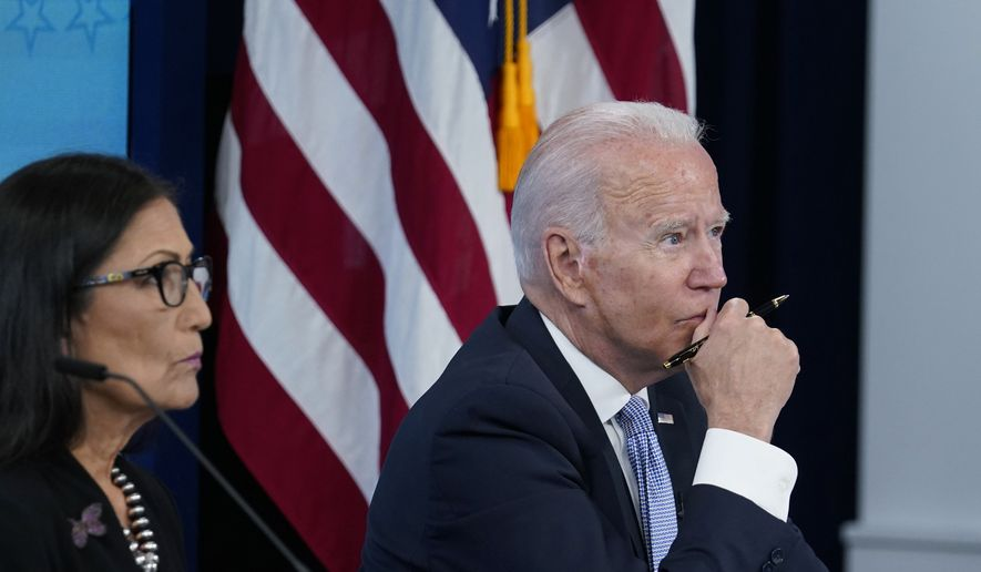President Joe Biden, right, sitting next to Interior Secretary Deb Haaland, left, listens during an event in the South Court Auditorium on the White House complex in Washington, Wednesday, June 30, 2021, with cabinet officials and governors from Western states to discuss drought and wildfires. (AP Photo/Susan Walsh)