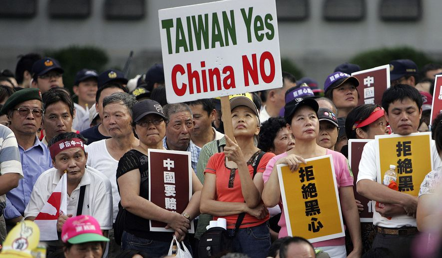 Tens of thousands of Taiwan supporters rally to denounce China in Taipei, Taiwan. (AP Photo/Wally Santana, File)
