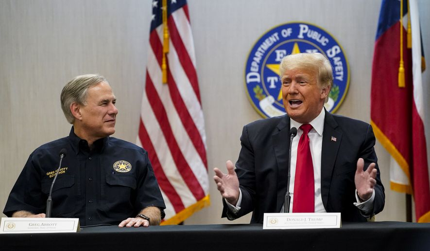 Texas Gov. Greg Abbott and former President Donald Trump attend a briefing with state officials and law enforcement at the Weslaco Department of Public Safety DPS Headquarters before touring the U.S.-Mexico border wall on Wednesday, June 30, 2021, in Weslaco, Texas.  Trump was invited to South Texas by  Abbott, who has taken up Trump's immigration mantle by vowing to continue building the border wall. (Jabin Botsford/The Washington Post via AP, Pool)