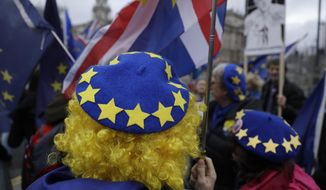 In this file photo dated Wednesday, Jan. 8, 2020, pro-Europe protesters demonstrate against Britain's Brexit split from the Bloc, outside the Houses of Parliament in London. (AP Photo/Matt Dunham, FILE)