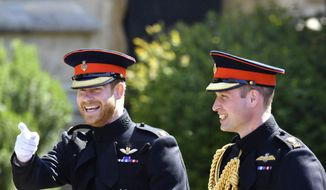 In this file photo dated Saturday, May 19, 2018, Britain's Prince Harry, left, reacts as he walks with his best man, Prince William the Duke of Cambridge, as they arrive for the wedding ceremony of Prince Harry and Meghan Markle at St. George's Chapel in Windsor Castle in Windsor, England. (Ben Birchhall/pool photo via AP, File)