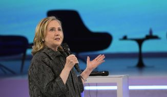 U.S. former Secretary of State Hillary Clinton delivers her speech during an international conference that aims to fast-track the road to gender equality and mobilize millions of dollars to achieve the long-sought goal quickly, at the Louvre Carrousel in Paris, France, Wednesday, June 30, 2021. (AP Photo/Michel Euler) ** FILE **