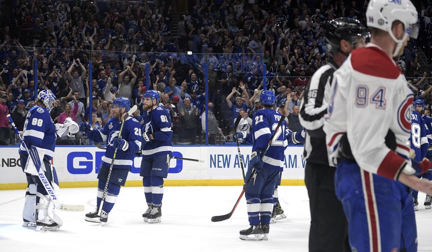 Montreal Canadiens right wing Corey Perry (94) skates off the ice as Tampa Bay Lightning goaltender Andrei Vasilevskiy is greeted by teammates after the third period in Game 2 of the NHL hockey Stanley Cup finals, Wednesday, June 30, 2021, in Tampa, Fla. The Lightning won 3-1. (AP Photo/Phelan Ebenhack) **FILE**