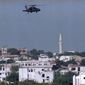 A U.S. Army Blackhawk helicopter patrols Mogadishu in the wake of gun battles between gunmen and U.N. peacekeepers protecting the U.N. military headquarters, June 8, 1993.  The city remained on edge after a night of clashes.  (AP Photo/Kathy Willens)