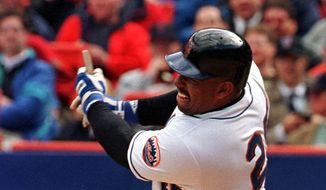 New York Mets' Bobby Bonilla ends up with a stub of a broken bat as he hits an RBI single during the fifth inning of the Mets home opener against the Florida Marlins in New York Monday, April 12, 1999. The Mets defeated the Marlins 8-1. A promotion announced Thursday, July 1, 2021, that allows a fan to book an Airbnb stay for four at Citi Field for $250 that includes use of the team gym and shower. The promotion includes throwing out the ceremonial first pitch before the Mets play Atlanta on July 28. (AP Photo/Osamu Honda) **FILE**
