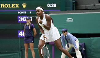 Coco Gauff of the US celebrates winning a point against Russia's Elena Vesnina during the women's singles second round match on day four of the Wimbledon Tennis Championships in London, Thursday July 1, 2021. (AP Photo/Alberto Pezzali)
