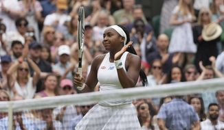 Coco Gauff of the US celebrates winning the women's singles second round match against Russia's Elena Vesnina on day four of the Wimbledon Tennis Championships in London, Thursday July 1, 2021. (AP Photo/Alberto Pezzali)