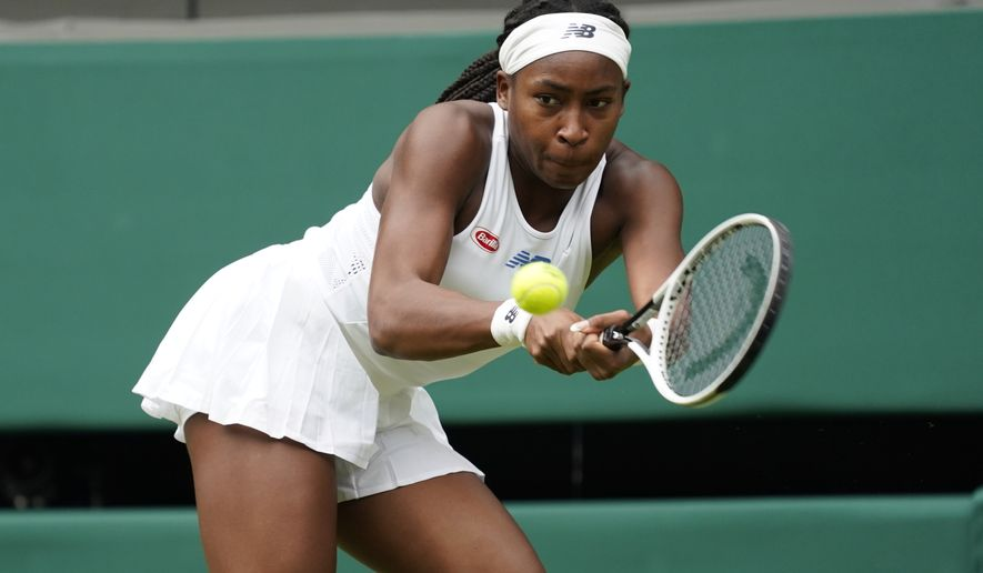Coco Gauff of the US plays a return to Russia's Elena Vesnina during the women's singles second round match on day four of the Wimbledon Tennis Championships in London, Thursday July 1, 2021. (AP Photo/Alberto Pezzali)