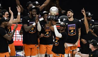 Phoenix Suns' Chris Paul hoists the trophy as he and his teammates celebrate after defeating the Los Angeles Clippers in Game 6 of the NBA basketball Western Conference Finals Wednesday, June 30, 2021, in Los Angeles. (AP Photo/Jae C. Hong) **FILE**