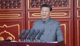 In this photo provided by China's Xinhua News Agency, Chinese President and party leader Xi Jinping delivers a speech at a ceremony marking the centenary of the ruling Communist Party in Beijing, China, Thursday, July 1, 2021. (Li Xueren/Xinhua via AP)