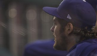 Los Angeles Dodgers starting pitcher Trevor Bauer looks on from the dugout during the fourth inning of a baseball game against the Washington Nationals, Thursday, July 1, 2021, in Washington. (AP Photo/Julio Cortez) **FILE**