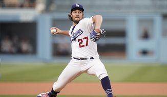 Los Angeles Dodgers starting pitcher Trevor Bauer throws against the San Francisco Giants during the first inning of a baseball game, Monday, June 28, 2021, in Los Angeles. (AP Photo/Jae C. Hong) **FILE**