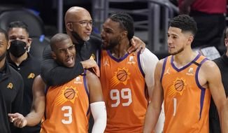 Phoenix Suns head coach Monty Williams, second from left, hugs Chris Paul, left, and Jae Crowder, second from right, as Devin Booker stands by as time runs out in Game 6 of the NBA basketball Western Conference Finals against the Los Angeles Clippers Wednesday, June 30, 2021, in Los Angeles. The Suns won the game 130-103 to take the series 4-2. (AP Photo/Mark J. Terrill) **FILE**