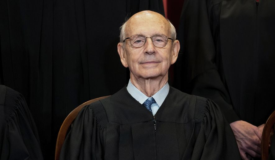 FILE - In this April 23, 2021, file photo, Supreme Court Associate Justice Stephen Breyer sits during a group photo at the Supreme Court in Washington. The Supreme Court is wrapping up its first all-virtual term, with decisions expected in a key case on voting rights and another involving information California requires charities to provide about donors. The court's last day of work Thursday, July 1, before its summer break also could include a retirement announcement, although the oldest of the justices, Breyer, has given no indication he intends to step down this year. (Erin Schaff/The New York Times via AP, Pool)