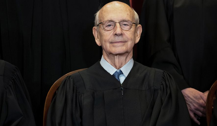 In this April 23, 2021, photo, Supreme Court Associate Justice Stephen Breyer sits during a group photo at the Supreme Court in Washington. (Erin Schaff/The New York Times via AP, Pool) **FILE**
