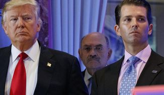 FThis file photo from Wednesday Jan. 11, 2017, shows President-elect Donald Trump, left, his chief financial officer Allen Weisselberg, center, and his son Donald Trump Jr., right, during a news conference at Trump Tower in New York. (AP Photo/Evan Vucci, File)