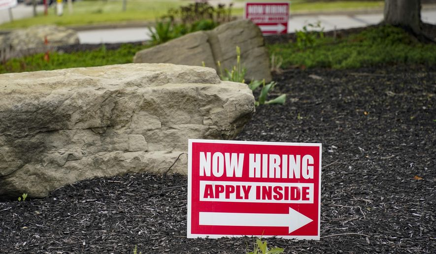 This May 5, 2021, file photo shows hiring signs posted outside a gas station in Cranberry Township, Butler County, Pa. (AP Photo/Keith Srakocic) ** FILE **