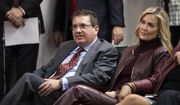 In this file photo, Washington Football Team owner Dan Snyder, left, and his wife Tanya Snyder, listen to head coach Ron Rivera during a news conference at the team's NFL football training facility in Ashburn, Va., in this Thursday, Jan. 2, 2020, file photo.  (AP Photo/Alex Brandon, File)  **FILE**