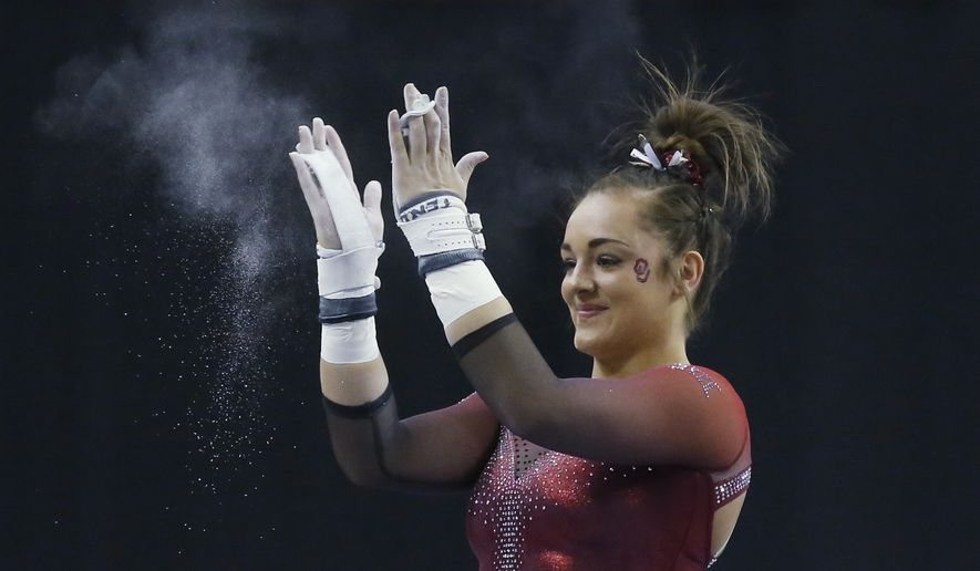 In this Feb. 16, 2019, file photo, Oklahoma gymnast Maggie Nichols reacts after her routine on the uneven bars in the Perfect 10 Challenge at the Bart and Nadia Sports Experience in Oklahoma City.  Nichols, an alternate on the 2016 U.S. Olympic team, welcomed opportunities for college-bound athletes to be compensated for their name, image and likeness. Nichols turned down several opportunities in 2016 to maintain her amateur status. She went on to win a pair of national titles at Oklahoma.(AP Photo/Sue Ogrocki, File) **FILE**