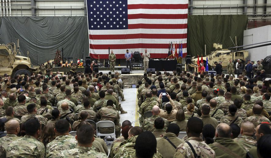 FILE - In this Dec. 24, 2017 file photo, Gen. Joseph Dunford, chairman of the Joint Chiefs of Staff speaks during a ceremony on Christmas Eve at Bagram Air Base, in Afghanistan. In 2001 the armies of the world united behind America and Bagram Air Base, barely an hours drive from the Afghan capital Kabul, was chosen as the epicenter of Operation Enduring Freedom, as the assault on the Taliban rulers was dubbed. It's now nearly 20 years later and the last US soldier is soon to depart the base. (AP Photo/Rahmat Gul, File)