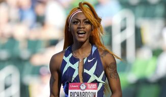 """In this June 19, 2021 photo, Sha'Carri Richardson celebrates after winning the first heat of the semis finals in women's 100-meter runat the U.S. Olympic Track and Field Trials in Eugene, Ore.    Richardson cannot run in the Olympic 100-meter race after testing positive for a chemical found in marijuana.  Richardson, who won the 100 at Olympic trials in 10.86 seconds on June 19, told of her ban Friday, July 2 on the """"Today Show.""""(AP Photo/Ashley Landis) **FILE**"""