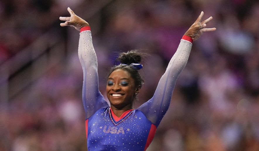 Simone Biles celebrate her performance on the vault during the women's U.S. Olympic Gymnastics Trials Friday, June 25, 2021, in St. Louis. (AP Photo/Jeff Roberson) **FILE**
