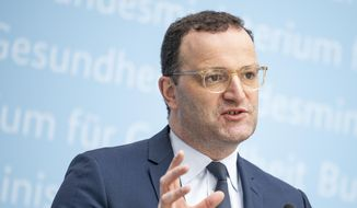 Jens Spahn (CDU), Germany's Federal Minister of Health, comments at a press conference on the consequences of the STIKO recommendation to administer an mRNA vaccine after a first vaccination with Astrazeneca in Berlin, Germany, Friday, July 2, 2021. (Fabian Sommer/dpa via AP)