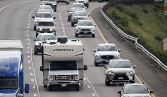 In this July 1, 2021, file photo, motorists head west along Interstate 70 to get an early start on the Fourth of July holiday weekend near Golden, Colo. Americans enjoying newfound liberty are expected to travel and gather for cookouts, fireworks and family reunions over the Fourth of July weekend in numbers not seen since pre-pandemic days. (AP Photo/David Zalubowski, File)