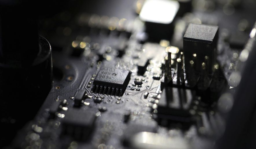 This Feb 23, 2019, file photo shows the inside of a computer in Jersey City, N.J. A ransomware attack paralyzed the networks of at least 200 U.S. companies on Friday, July 2, 2021, according to a cybersecurity researcher whose company was responding to the incident. (AP Photo/Jenny Kane, File)  **FILE**