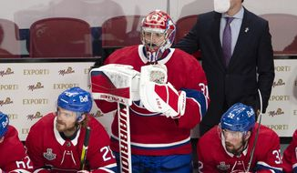 Montreal Canadiens goaltender Carey Price (31) watches from the bench after being pulled for an extra attacker during the third period of Game 3 against the Tampa Bay Lightning in the NHL hockey Stanley Cup Final, Friday, July 2, 2021, in Montreal. (Ryan Remiorz/The Canadian Press via AP) **FILE**