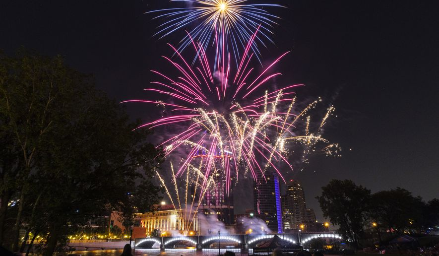 The Fourth of July fireworks show is seen from Ah-Nab-Awen Park in Grand Rapids, Mich., on Saturday, July 3, 2021. (Joel Bissell/MLive.com/Kalamazoo Gazette via AP)