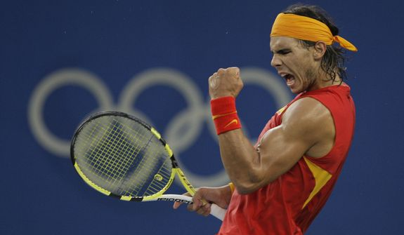 Rafael Nadal of Spain reacts to winning a point against Fernando Gonzalez of Chile during their Gold medal singles tennis match at the Beijing 2008 Olympics in Beijing, in this Sunday, Aug. 17, 2008, photo. Nadal will not be participating in the Tokyo Games. (AP Photo/Elise Amendola) **FILE**