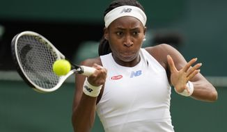 Coco Gauff of the U.S. plays a return to Germany's Angelique Kerber during the women's singles fourth round match on day seven of the Wimbledon Tennis Championships in London, Monday, July 5, 2021. (AP Photo/Kirsty Wigglesworth)