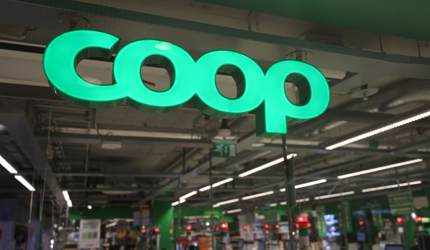 In this July 3, 2021 file photo, a Coop supermarket store in Stockholm, Sweden. Cybersecurity teams worked feverishly Sunday, July 4, 2021, to stem the impact of the single biggest global ransomware attack on record, with some details emerging about how the Russia-linked gang responsible breached the company whose software was the conduit. The Swedish grocery chain Coop said most of its 800 stores would be closed for a second day Sunday because their cash register software supplier was crippled. (Ali Lorestani/TT via AP, File)