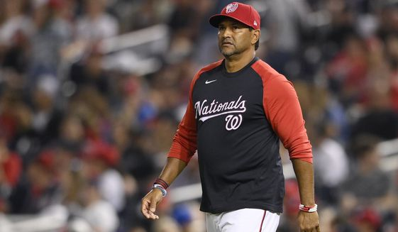 Washington Nationals manager Dave Martinez (4) walks to the mound during a baseball game against the Los Angeles Dodgers, Saturday, July 3, 2021, in Washington. The Dodgers won 5-3.(AP Photo/Nick Wass)