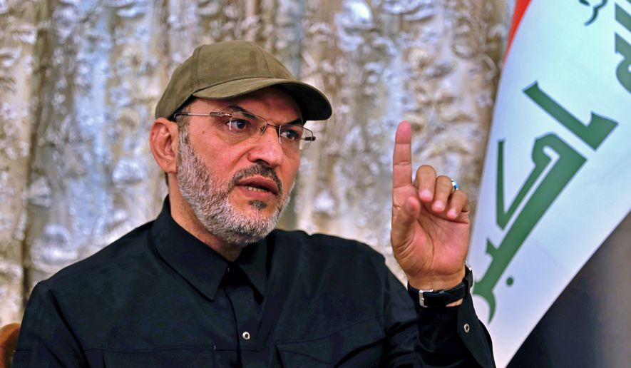 Abu Alaa al-Walae, commander of Kataib Sayyid al-Shuhada, speaks during an interview with The Associated Press, Monday, July 5, 2021, in Baghdad, Iraq. The leader of an Iran-backed Iraqi militia has vowed to retaliate against America for the death of four of his men in a U.S. airstrike along the Iraq-Syria border last month, saying it will be a military operation everyone will talk about. (AP Photo/Khalid Mohammed)