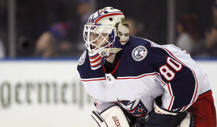 Columbus Blue Jackets goaltender Matiss Kivlenieks (80) is shown during the second period of an NHL hockey game in New York, in this Sunday, Jan. 19, 2020, file photo. The Columbus Blue Jackets and Latvian Hockey Federation said Monday, July 5, 2021, that 24-year-old goaltender has died. (AP Photo/Kathy Willens, File)