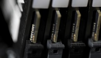This Feb 23, 2019, file photo shows the inside of a computer in Jersey City, N.J. (AP Photo/Jenny Kane, File)  **FILE**