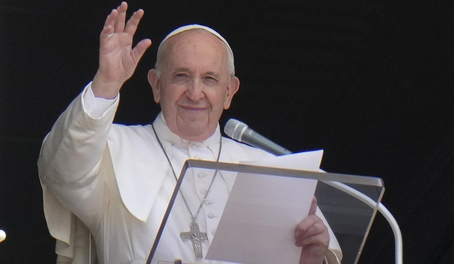 In this Sunday, July 4, 2021, photo, Pope Francis waves to the crowd as he arrives to recite the Angelus noon prayer from the window of his studio overlooking St.Peter's Square, at the Vatican. In a brief announcement Sunday afternoon the Vatican said Pope Francis has gone to a Rome hospital for scheduled surgery for a stenosis, or restriction, of the large intestine. (AP Photo/Alessandra Tarantino) **FILE**