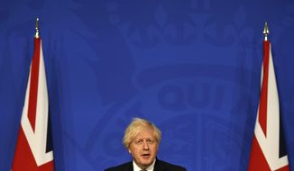 Britain's Prime Minister Boris Johnson speaks during a media briefing on coronavirus in Downing Street, London, Monday, July 5, 2021. Johnson on Monday confirmed plans to lift mask requirements and social distancing rules as planned on July 19 despite a surge in infections. (Daniel Leal-Olivas/Pool Photo via AP)