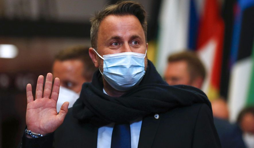 """In this Friday, June 25, 2021, file photo, Luxembourg's Prime Minister Xavier Bettel leaves at the end of the first day of an EU summit in Brussels. Luxembourg Prime Minister Xavier Bettel was in observation in hospital early Monday, July 5, 2021, """"as a precautionary measure"""" after he had tested positive for COVID-19 a week earlier. (Aris Oikonomou, Pool Photo via AP, File)"""