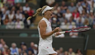 Germany's Angelique Kerber celebrates winning a game against Czech Republic's Karolina Muchova during the women's singles quarterfinals match on day eight of the Wimbledon Tennis Championships in London, Tuesday, July 6, 2021.(AP Photo/Alastair Grant)