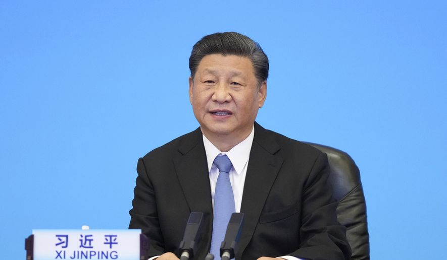 In this photo released by Xinhua News Agency, Chinese President Xi Jinping delivers a speech at the CPC and World Political Parties Summit held in Beijing Tuesday, July 6, 2021. (Li Xueren/Xinhua via AP) ** FILE **
