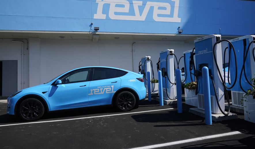 Chargers for electric cars are displayed at an opening ceremony for a Revel electric vehicle charging hub in the Brooklyn borough of New York, Tuesday, June 29, 2021. (AP Photo/Seth Wenig)