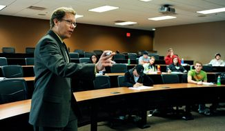 John Bitzan teaching at North Dakota State University, where he is the director of the Sheila and Robert Challey Institute for Global Innovation & Growth. (Photo courtesy of Mr. Bitzan)