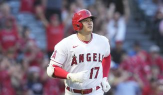 Los Angeles Angels designated hitter Shohei Ohtani (17) runs to first base during a baseball game against the Baltimore Orioles Friday, July 2, 2021, in Anaheim. (AP Photo/Ashley Landis)