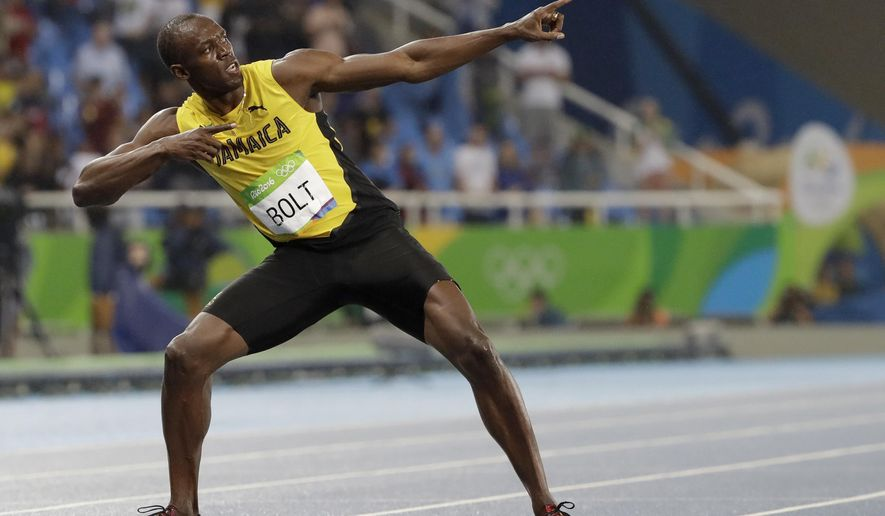 FILE - Usain Bolt from Jamaica celebrates winning the gold medal in the men's 200-meter final during the athletics competitions of the 2016 Summer Olympics at the Olympic stadium in Rio de Janeiro, Brazil, in this Thursday, Aug. 18, 2016, file photo. The retired world's fastest man is not only changing diapers these days, but also distances as he makes a brief comeback for a promotional event. (AP Photo/David J. Phillip, File)